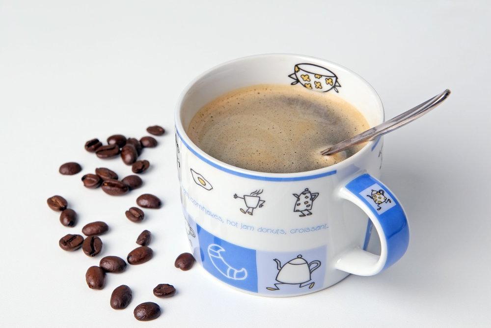 Kaffeetasse mit Bohnen dekoriert   - weiter zur Fotogalerie
